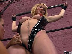 Blonde and brunette girls in latex clothes have an amazing lesbian sex. The blonde girl gets her pink pussy and ass fisted deep.