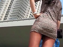 Horny voyeur likes filming hottie under her skirt in outdoor upskirt fetish session
