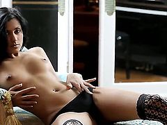 Breathtakingly beautiful Leila in hot stockings is playing with her own sexy shaved pussy