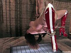 Tied up blonde babe stands on her knees getting fucked in her mouth. After that she gets toyed and humiliated.