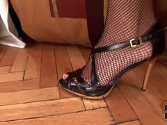 Kinky short haired domina CJ in fishnet stockings plays with mans dick before she takes off her stiletto. Then she makes obedient guy lick her feet and suck her toes with her mesh stockings on.