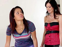 Dark haired lesbian mom Kendra Lust finds sweet young ebony chick Aria Salazar very attractive. She does her best to seduce cute dark skinned girl. Watch them talk and kiss on the couch.