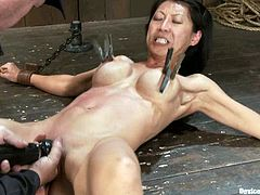 Amazing Asian chick Tia Ling is lying nude and chained on the floor in a dirty basement. Some guy finger-fucks Tia's snatch and enjoys the way she moans in pleasure.