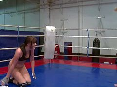 Attractive young brunette bitches Bijou and Jessica Lux with nice natural boobs in tight booty shorts get naked during arousing chick fight in the ring and wrestle on the floor