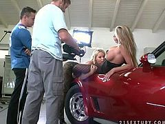 Long haired blonde with huge firm hooters in sexy body stockings gets her twat licked good by young bitch with dark heavy make up on a red sports car at the photo shoot