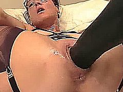 Amateur BBW has her huge cunt fisted and fucked with a monster dildo till she orgasms