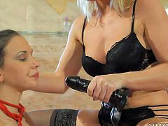 Lesbian mistress Kathia Nobili in black nylons and makes her lesbian slave Candy Sweet lick her sweet snatch. Then alluring leggy nude girl gets her hole strapon fucked from behind by hot domina.