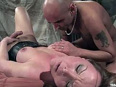 Salacious blonde shemale Danielle Foxxx is having fun with Diezel indoors. She binds and torments the man and then fucks his butt deep and hard.
