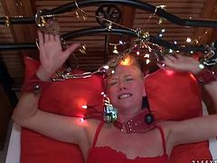 Short haired blonde Cassidy dressed in red gets cuffed to bed before she takes cock. She gives head and then gets her pink hole fucked with her red lace panties on. Watch slave girl get screwed from your point of view.