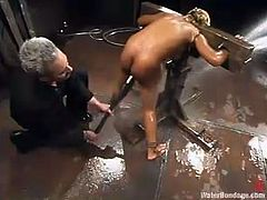 Hot Black girl gets tied up and hosed. After that the guy starts to toy her wet pussy with big dildo and then he puts her in special aquarium filled with cold water.