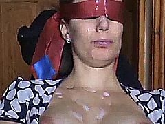 Michel Steuve after have blindfolded and tied his wife Colette Choisez on a chair, invites the neighbor that Colette hates the most, to come jerk off and ejaculate on her. He lets the guy to empty the balls on his wife, to put him his jizz everywhere on the face and the naked boobs while that she's filmed by his hubby.