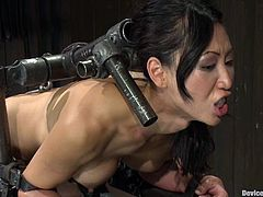 Isis Love and Tia Ling in great BDSM video. The Asian girl gets bonded and fucked with strap on from behind.