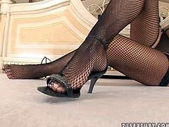 Hannah Hunter is a dangerously beautiful brunette in black lingerie, Stunning babe in black mesh stockings exposes her lovely legs and takes off her shoes. She demonstrates her sexy feet!