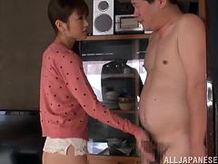 Amazingly hot Japanese girl takes her skirt off and sits down on guy's face to let him lick her pussy. She also gives him a footjob and handjob.