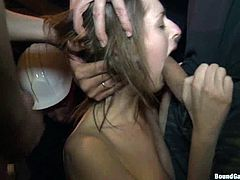 Gorgeous girl sucks big dicks in a dungeon and then gets tied up. After that she gets double penetrated.