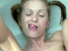 Skinny bitch has golden shower action and plays with bat
