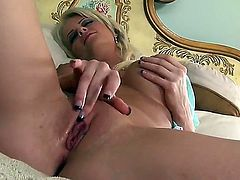 Hot and sexy blonde girl Emily Addison showing off her tight big fake boobs and spreading legs to show her masturbation and fingering actions.