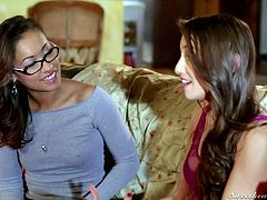 Four-eyed ebony girl Skin Diamond and sweet white chick Celeste Star are horny for each other. They kiss with passion on the couch in the living room and then Skin Diamond bares her natural tits.
