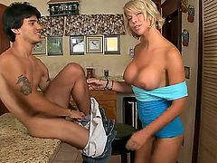 Amazing blonde babe is showing her huge titties on tape, while her sexy young boyfriend is licking out her at her kitchen. Enjoy Brianna Beach having a nice sex.