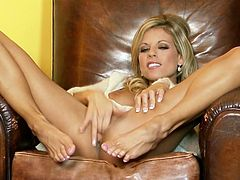 Kinky slim blondie is just bright and sexy. This nympho has a pair of nice long legs. Torrid girlie jams her tits and stretches legs wide right in the leather armchair for tickling her cunt tenderly.