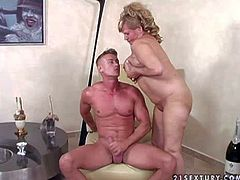 Lusty full figured mature blonde whore stuffs her shaved cunt with long red vibrator while giving head to young buck with six pack and rides on stiff sausage to orgasm