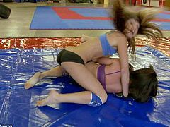 Doris Ivy and Sandra Rodriguez are two pretty lesbian girls that take off their uniform during the match. Blonde and brunette show off their natural perky tits and shaved pussies at the gym.