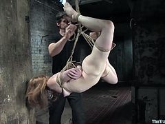 See how this submissive redhead ends up swallowing her master's big load in this bondage clip after being tortured while being tied up.