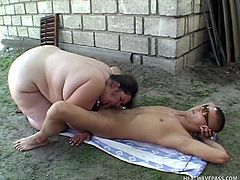 She's big, white and likes wondering naked outside. Bbw Bear delights us with her immense white ass and her cock sucking skills. The slut rides a rodeo sex machine and then finds a guy that was laying on the ground relaxing. She couldn't leave him all alone could she? Well let's see her getting some milk from him