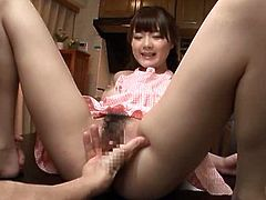Smoking hot and luscious Japanese siren gets naked and starts sucking his cock in the kitchen. No time for cooking at all.