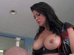 Raquel Devine is a smoking hit milfy domina with strap-on dildo. She fucks guys mouth and displays her massive tits at the same time. Watch men get dominated in the middle of the room.