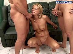 Dirty and horny momma Valery enjoys in taking on two hard rods at the same time and getting a hot double penetration feeling inside of her on the couch in her threesome
