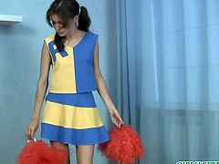 Naughty cheerleader exercises her dildo routine