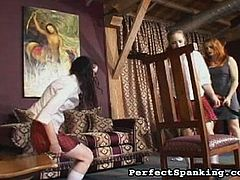 Their redhead principal just can't take it anymore how these bitchy schoolgirls behave at school. So she decided to give them both a lessons by hitting their butt cheeks with a whip.