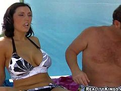 Dark haired woman in black and white bikini gets picked up by MILF Hunter on the beach. They have a great time together. He touches her boobs in public place curiously. Watch her get seduced!