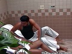 Big titted ebony shemale is having fun with a latino boy! They switch turns and fuck on each other's tight assholes like crazy!