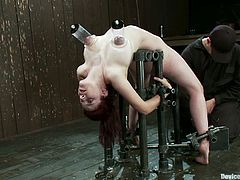 Iona Grace is the girl featured in this extreme bondage BDSM porn video where she gets her shaved pussy toyed while immobile.