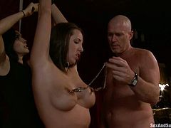 Nasty chick Isis Love is having fun with Mark Davis and his assistant in a living room. Isis gets tied up and enjoys pegs on her nipples before getting her cunt fisted and drilled.