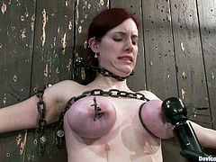 This petite redhead angel is being abused and that is something that she likes. So honey gets chained on the wall and then played on her hot muff!