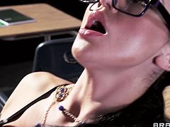 Busty college prof Audrey Bitoni is ready to do whatever it takes to please her student. Watch her devouring his thick dong before her pussy is rammed balls deep into ecstasy.