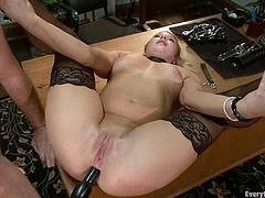 Stunning Aurora Snow rides big dildo sitting on a table. After that she get her ass gaped with metal tongs. Of course, then she gets ass fucked.