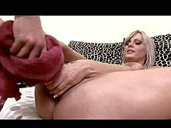 Smoking hot pretty blonde Sheila Grant with natural gigantic gazongas and arousing make up in stripper shoes only teases and stuffs her shaved cunt with baseball bat at the interview