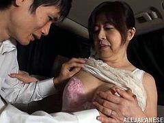 Filthy Old Mature Babe Strips And Gives A Handjob In A Car To A College Dude That Loves Fucking Grannies.