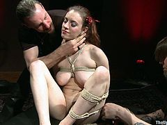With huge natural tits and an amazing ass, this hottie's the perfect slave to have fun with. Watch this bondage scene where her master and mistress play with her.