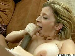 Seductive blonde cougar with delicious ass and huge jaw dropping knockers gives head and amazing titjob to randy black stud and gets her shaved cunny drilled deep from behind