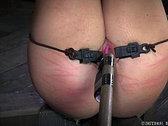 Amateur girl is tied up and restricted. She's a slave and can't move. Her legs are in the air and she's getting her pussy toyed and her ass whipped.