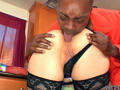 This escaped convict breaks into blonde Nina Hartley's house and starts licking her ass. She puts some type of sauce on her milf ass and he licks that off too. Then he really tongues her asshole while she stands there in her black stockings.