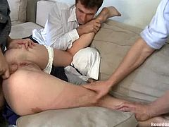 Tied up girl has wild sex with three guys. She sucks their big dicks and then gets double penetrated.