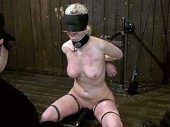 Naughty blonde girl gets blindfolded and clothespinned. After that she gives a blowjob and also gets whipped.