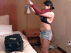 Brunette best door Jayden demonstrates her nice natural boobs while giving interview. She talks to camera man sitting on the edge of the bed in a hotel room. She is going to show her nice melons again.