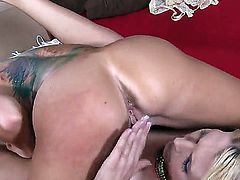 Wild and whorish tattooed brunette and kinky blonde lesbians Alicia Secrets and Romi Rain with gigantic hooters and long legs get naked and play with strap on to loud orgasms.